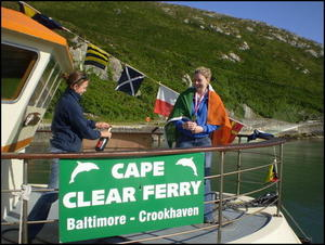 World champion Aoife Sheehan returns in triumph to Cape Clear Island aboard the Cailín Óir